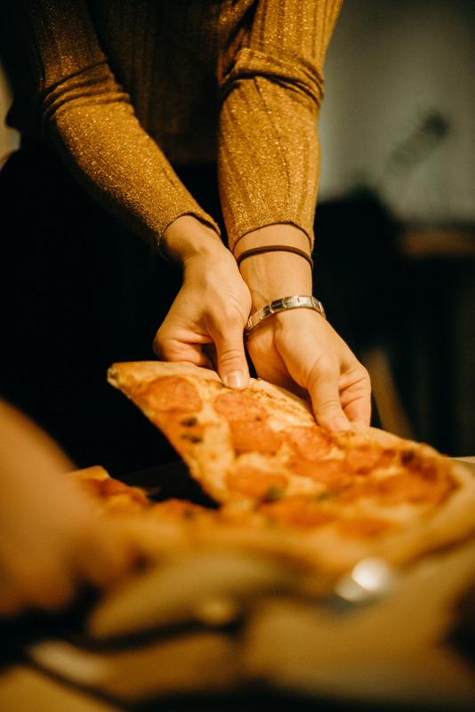 Canva - Woman Picking Pizza